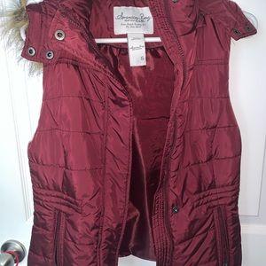 Red vest with fur hood